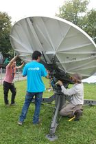 One of the international teams (left: WFP, middle: Unicef, right: Radar Australia) building a satellite system. (show image)