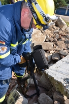 With a search cam, the experts search for missing people under the debris.  (show image)