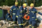 THW-volunteers practice the rescue of trapped people from debris.  (show image)