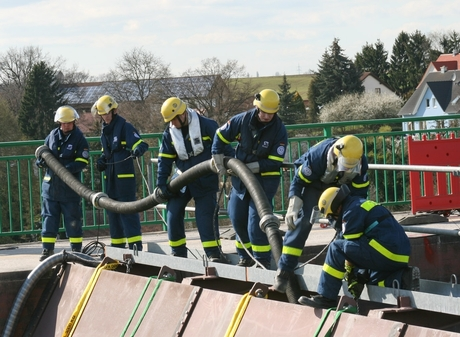 Volunteers prepare for a pumping exercise.