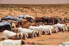In the refugee camps, the people lived under the most adverse conditions.  (show image)