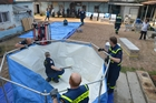 THW operatives setting up the water purification plant.  (show image)