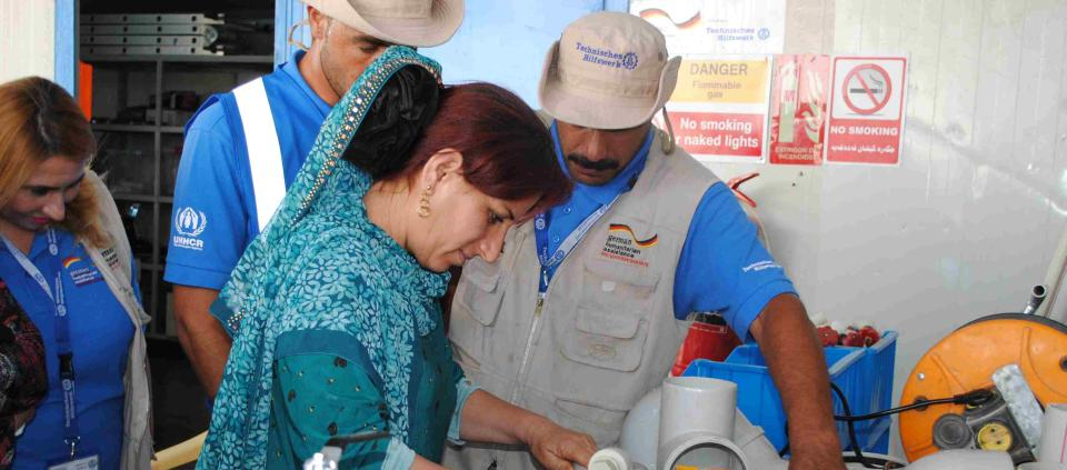 In a workshop, women learn how to use the tools and technique provided by the tool hire service.