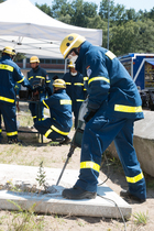 The drill hammer is an effective tool when volunteers have to get through concrete. (show image)